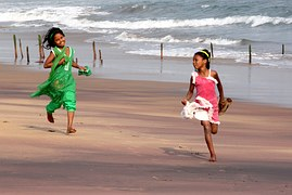 children_playing_running_sandy_beach
