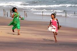 services_children_playing_running_sandy_beach