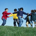 children_circle_playing_energetic_grass_sky