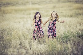 sisters_playing_loving_running_free_field_grass_summer_holding_hands