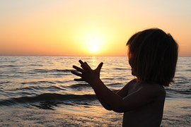 colorful_sunrise_child_young_happy_clapping_beach_warm