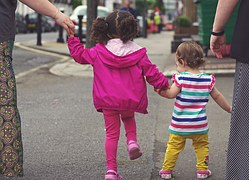 children_walking_holding hands_adult supervision