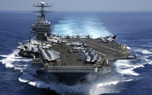 aircraft carrier, floating, loaded, airplanes on it, in water, moving, in ocean